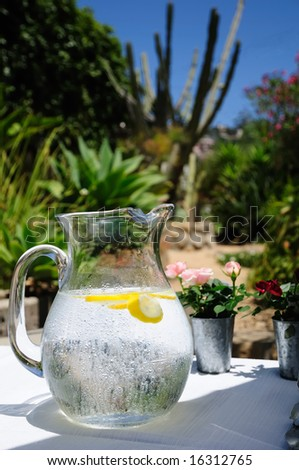 A water pitcher with droplets of condensation on a buffet table in the American Southwest. - stock photo