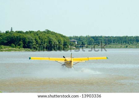 A water plane cruising along the river about to take off - stock photo