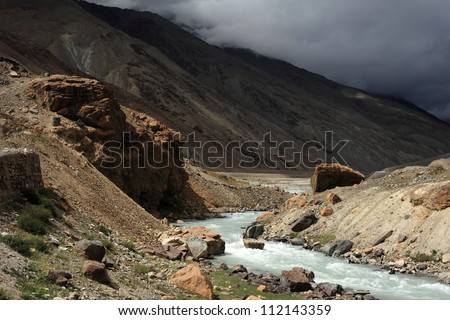 A water stream passing through Himalaya mountains - stock photo