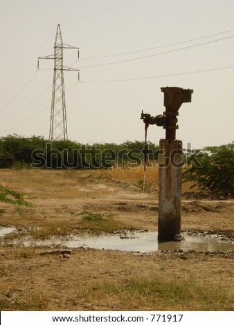 a water tap in a village in india - stock photo