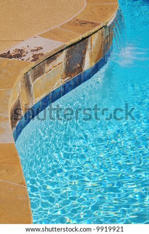 A waterfall at a suburban pool - stock photo