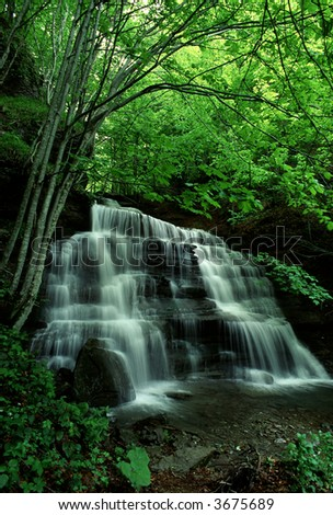 a waterfall during springtime