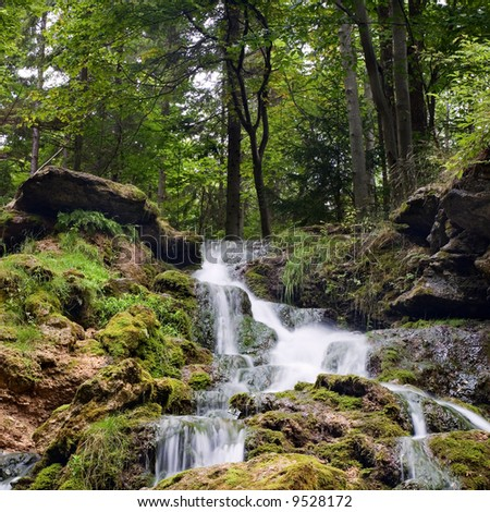 a waterfall in forest - stock photo