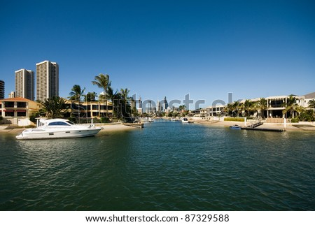 A waterway scene, with luxury homes and apartment buildings, Surfers Paradise, Queensland, Australia - stock photo