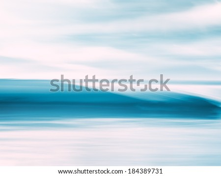 A wave breaking along the Pacific coast.  Image has been abstracted with panning motion combined with a long exposure. - stock photo
