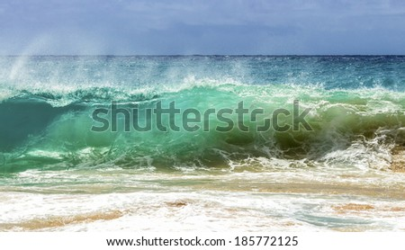 A wave breaking on the shore of Sandy Beach on Oahu, Hawaii - stock photo