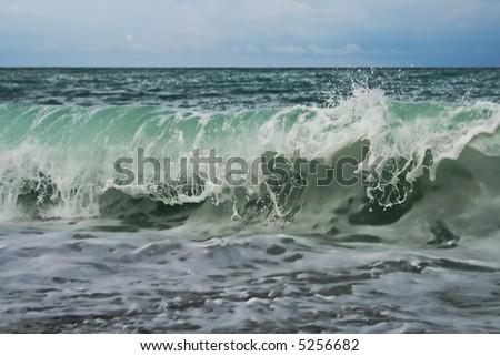 A wave hitting the coast - stock photo