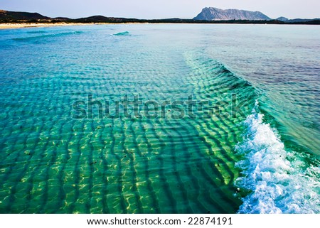 A wave in the Tyrrhenian Sea near la Cinta beach, Sardinia, Italy - stock photo