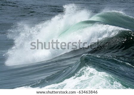 A wave is breaking at the coast of Australia.