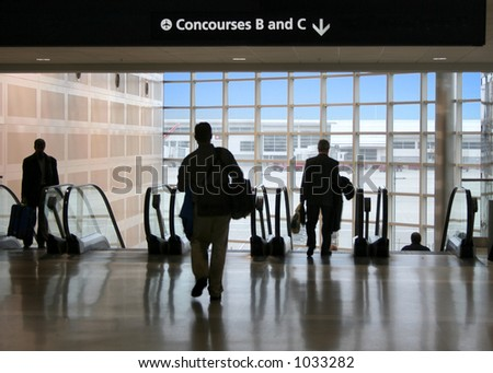 A wave of travelers head for the far gates - stock photo