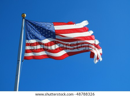 a waving america flag against blue sky