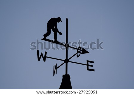 A weather vain on a clear blue sky - stock photo