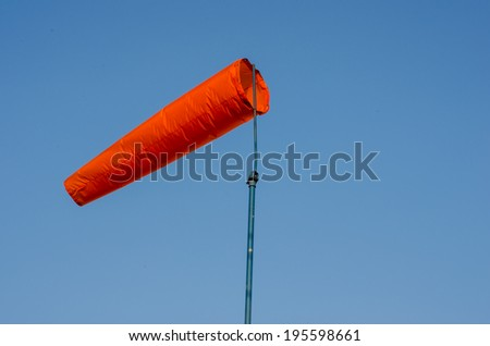 A weather vane at the chemical factory with  blue sky - stock photo