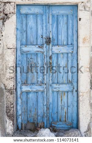 A weathered blue door on the island of Santorini, Greece, Europe - stock photo