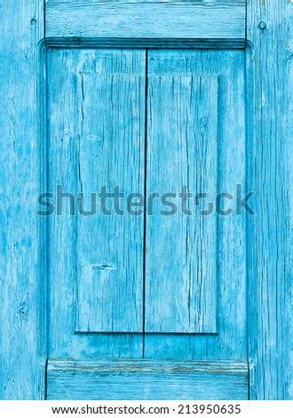 A weathered blue wooden panel - stock photo
