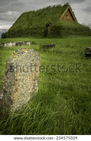 A weathered grave marker - stock photo