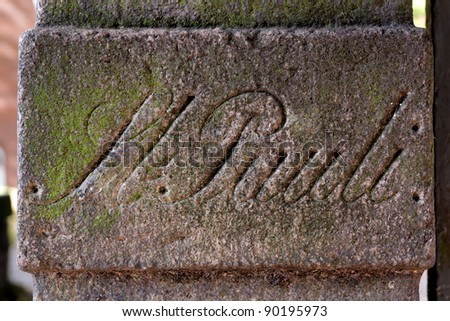 A weathered old stone, half covered in moss, announcing the famous quarter of St. Pauli, best known for its seedy red light district, located in the old Hanse port city of Hamburg, Germany. - stock photo