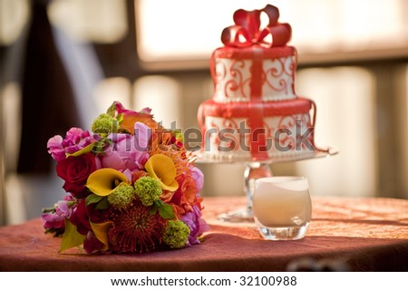 A wedding bouquet and a wedding cake