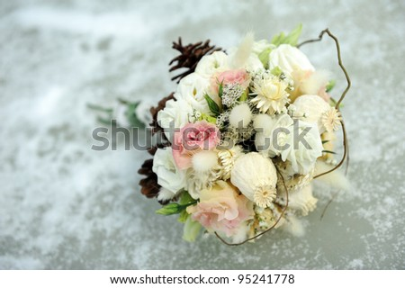 A wedding bouquet laying on river ice