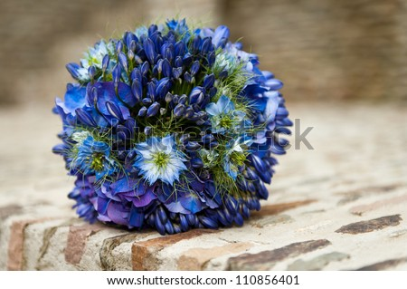 A wedding bouquet with Agapanthus (lily of the Nile), Nigella Damascena (love in a mist) and Hydrangea Macrophylla - stock photo