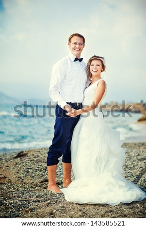 A wedding by the sea. Honeymoon. The bride and groom.