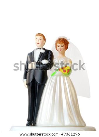 A wedding couple made of plastic, models for wedding cake, isolated on white background - stock photo