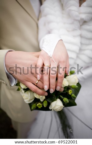 A wedding etude is in colors, weddings rings - stock photo