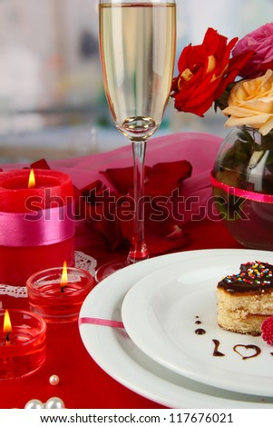 A wedding ring in glass as a gift on celebratory table in honor of Valentine's Day on room background - stock photo