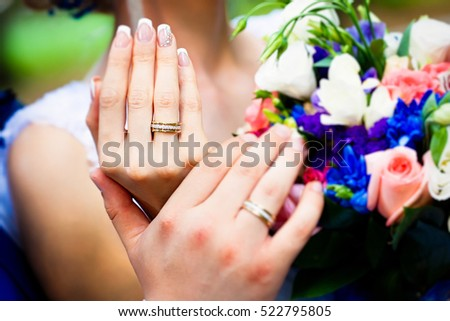A wedding ring on the finger of the bride, selective focus, selective focus