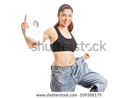 A weightloss woman holding a weight scale isolated on white background - stock photo