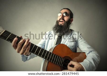 A weird guitarist - stock photo