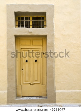 A weird single panel door in Mdina fabricated in such a way as to resemble the traditional double pane Malta door