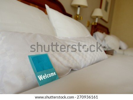 a welcome note in a hotel room - stock photo