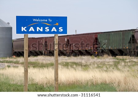 A welcome sign at the Kansas state line - stock photo