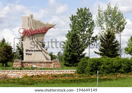 A welcome sign at the Minnesota state line. - stock photo