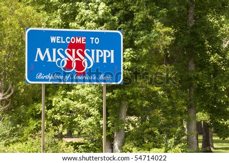 A welcome sign at the Mississippi state line. - stock photo