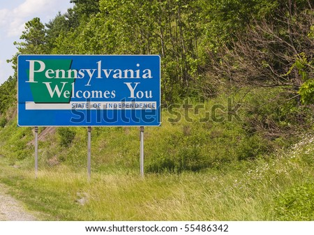 A welcome sign at the Pennsylvania state line. - stock photo