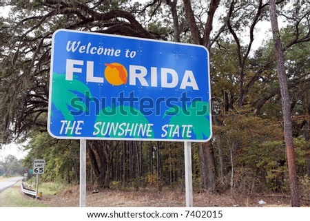 """A """"Welcome to Florida"""" sign at the state line. - stock photo"""