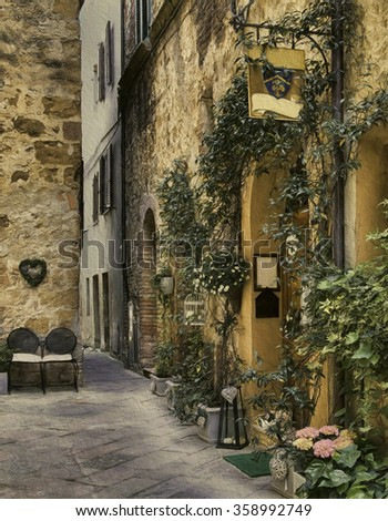 A welcoming side street in Pienza, Val d'Orcia, Siena, Italy - stock photo
