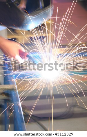 A welder in the factory - stock photo