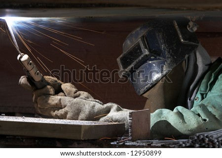 a welder working at shipyard during night shift