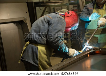 a welder working at the factory