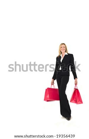 A well dressed attractive blond woman carrying shopping bags. Studio shot isolated on a white background with a small drop shadow for depth.