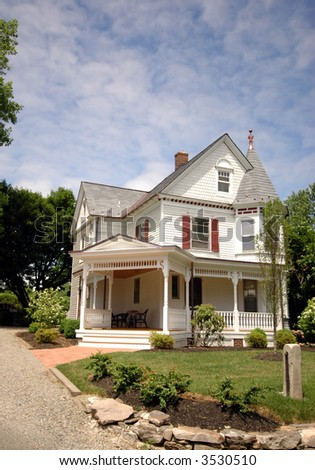 A well kept Victorian house on a sunny day - stock photo