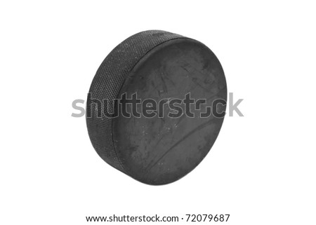 A well used hockey puck isolated on white background