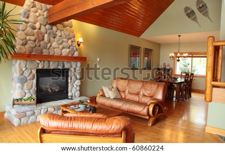 A west coast living and dining room with a river rock fireplace.