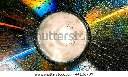 A wet dvd disc with water drops - stock photo