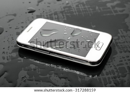 a wet smartphone - stock photo