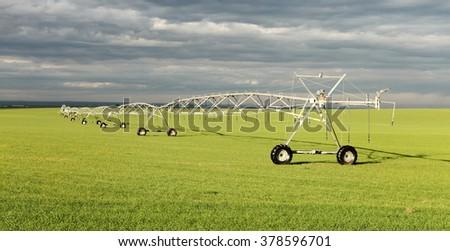 A wheel line used to irrigate an alfalfa field. - stock photo
