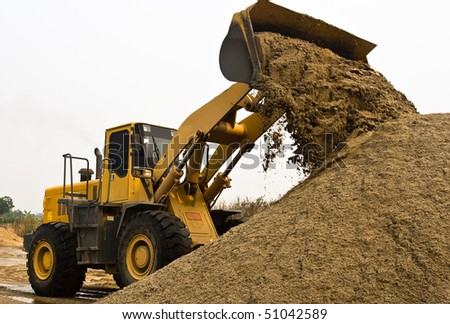 A wheel loader's working in a construction area.